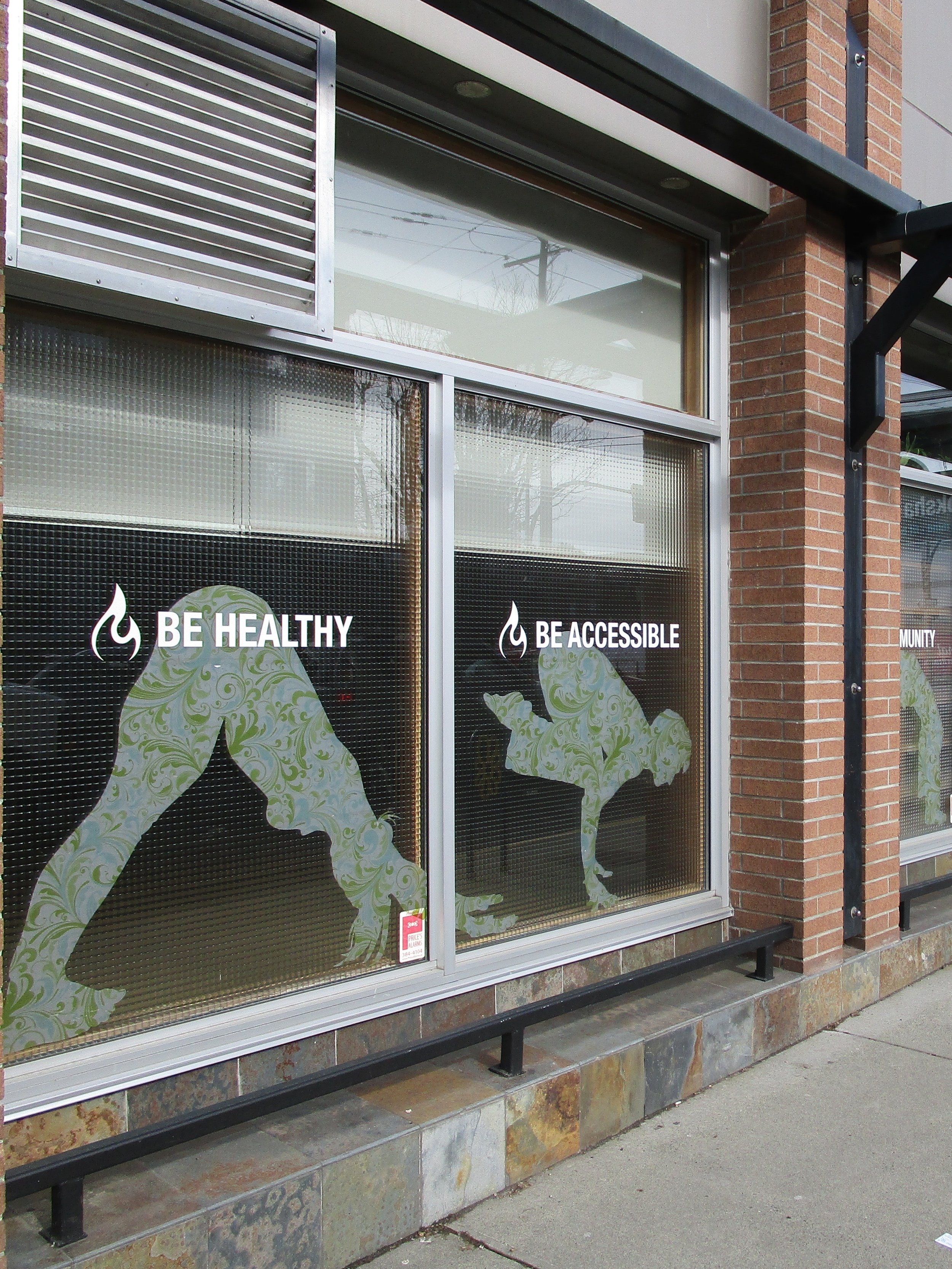 Metal bars outside a yoga studio at Fort and Cook. The same bars are outside the tax preparation company next door.