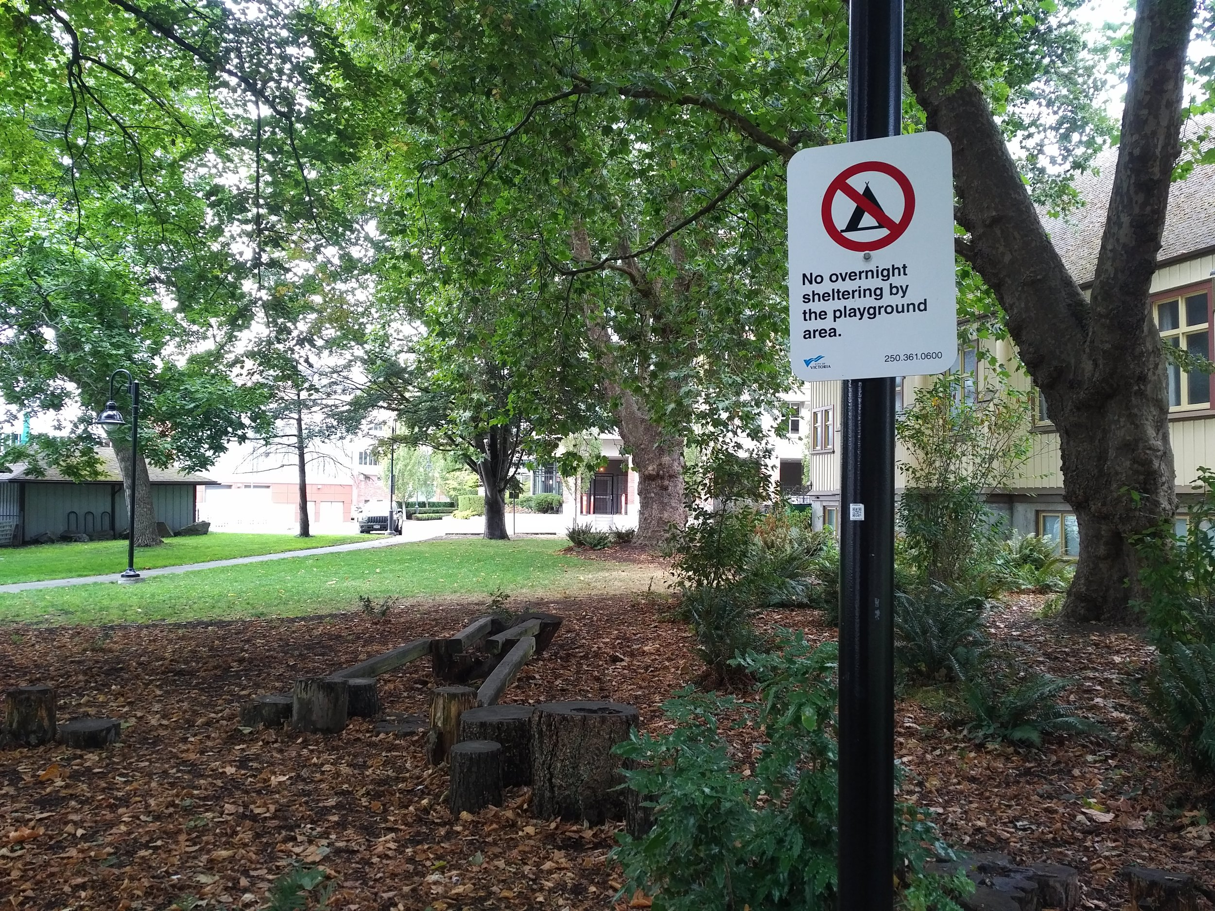 Rules upon rules. Camping is already banned in Cridge Park due to its size, but signs are up to tell people A) Not to camp; and B) Not to camp next to this stump-based playground. The City's website says Cridge Park  does not have a playground .