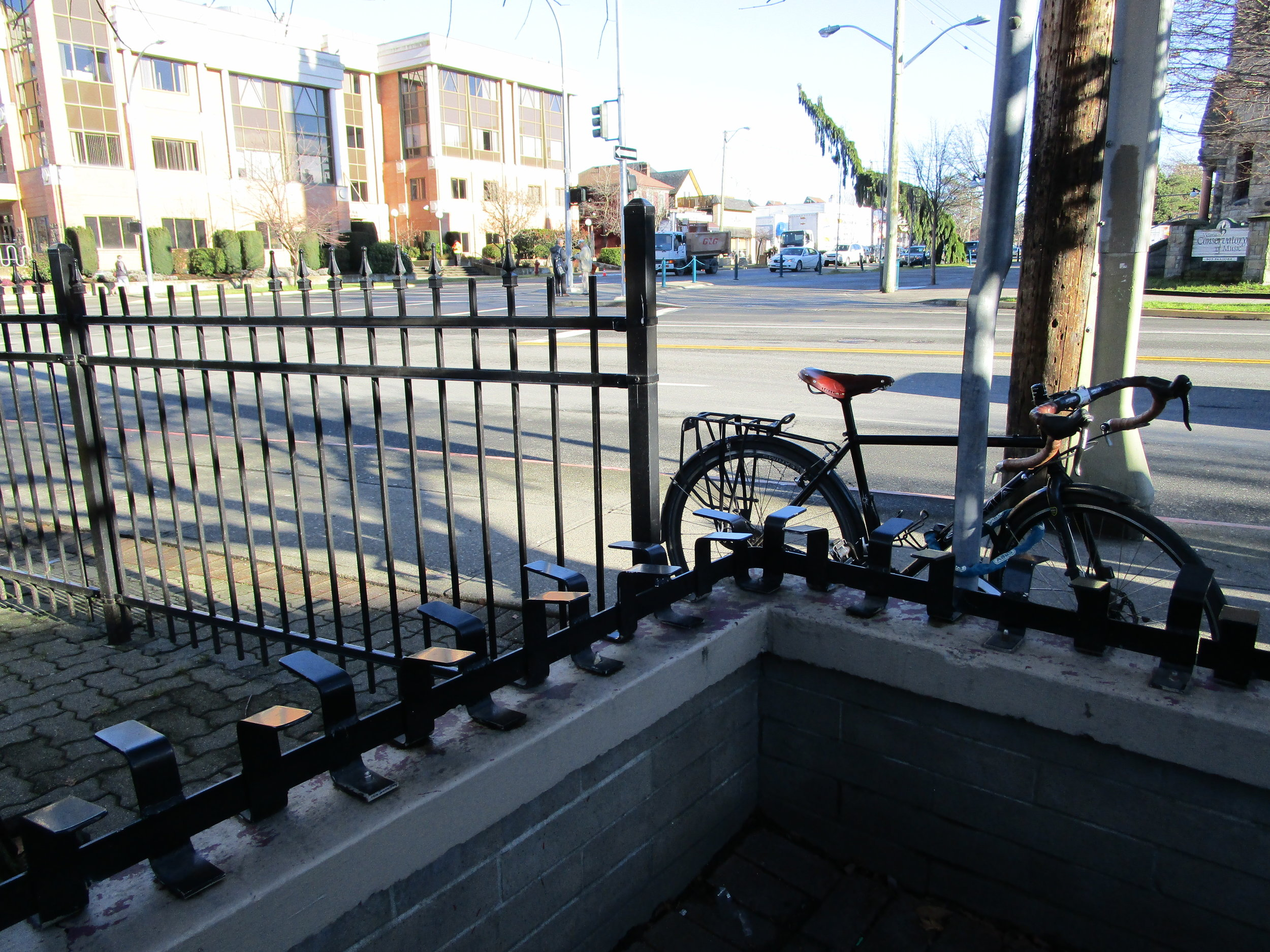 Metal bars stop people from sitting on ledges.