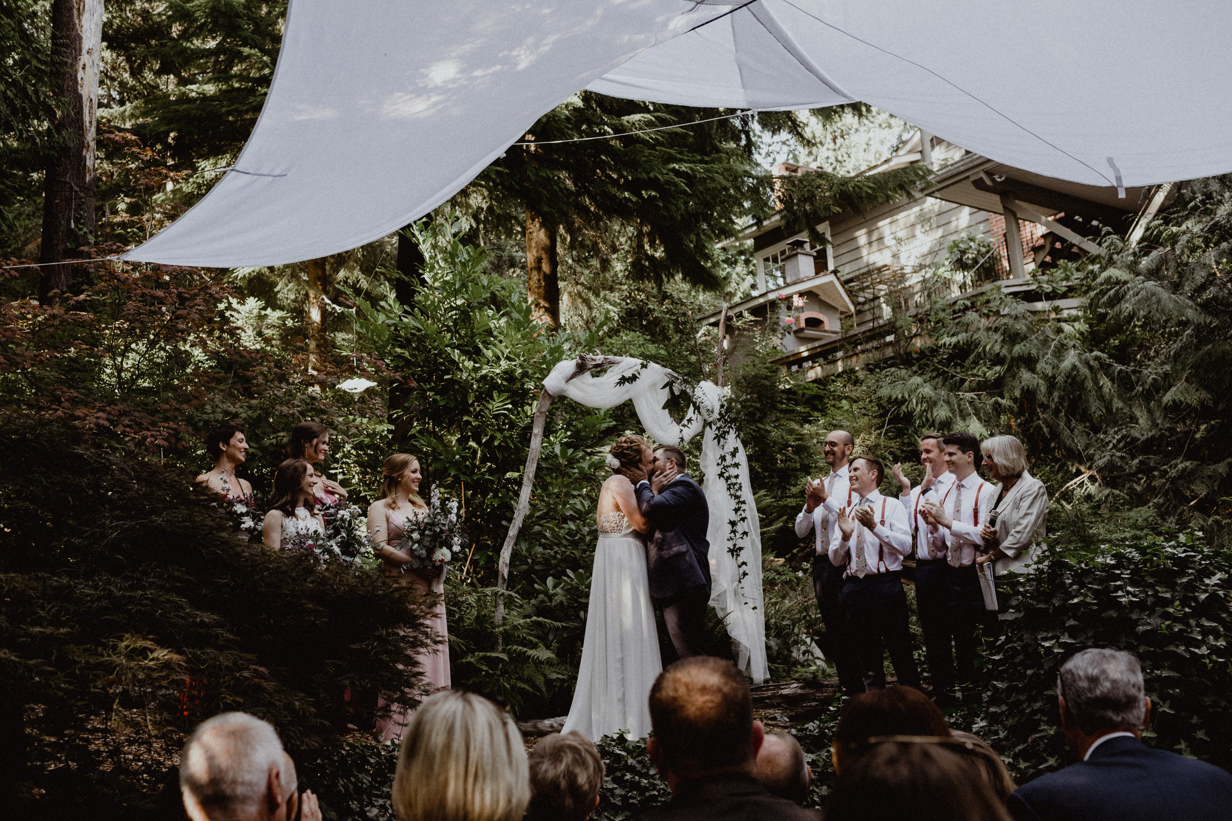 An intimate wedding ceremony photo at a backyard wedding in West Vancouver