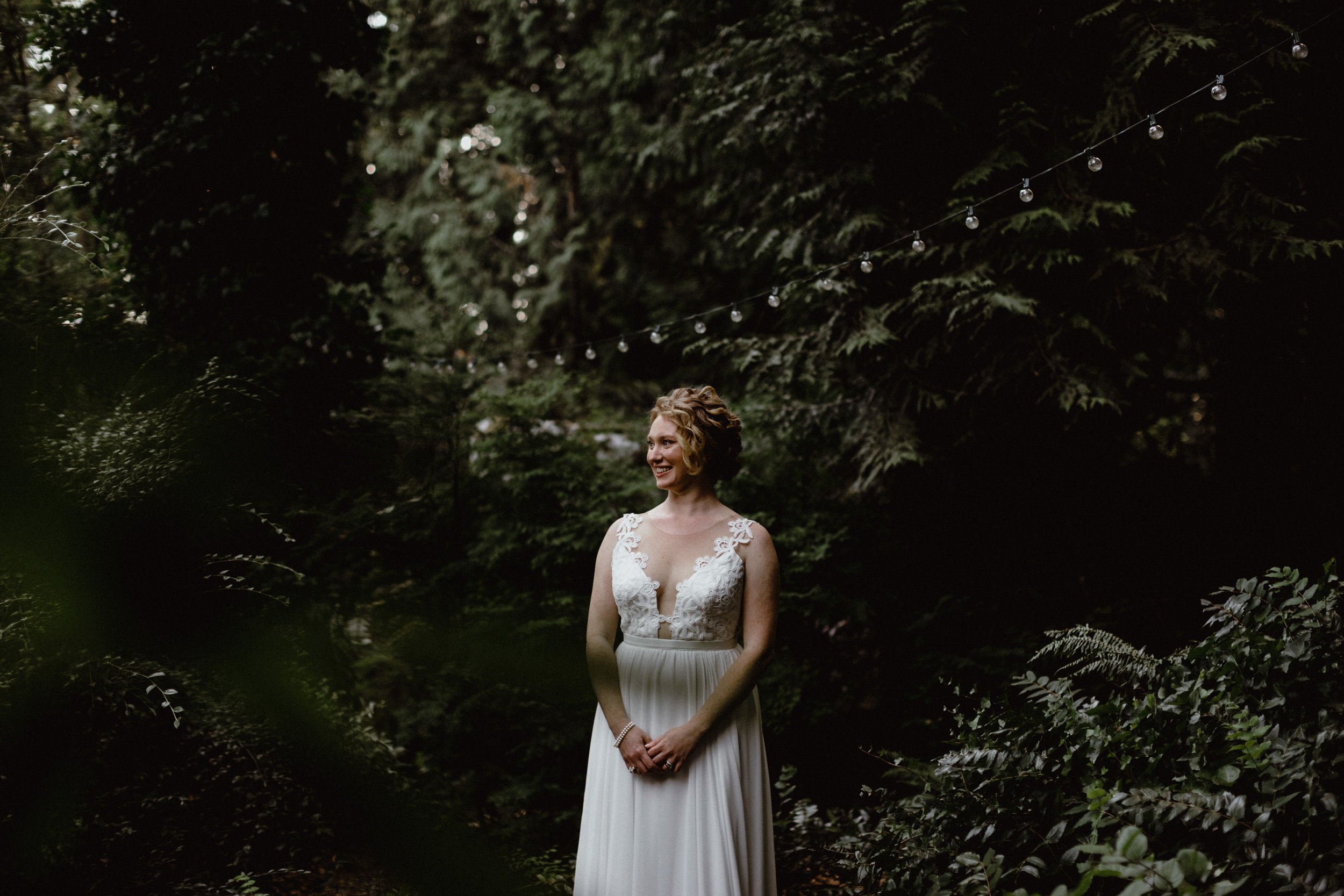 Bride wearing a Truvelle wedding dress in a Vancouver forest