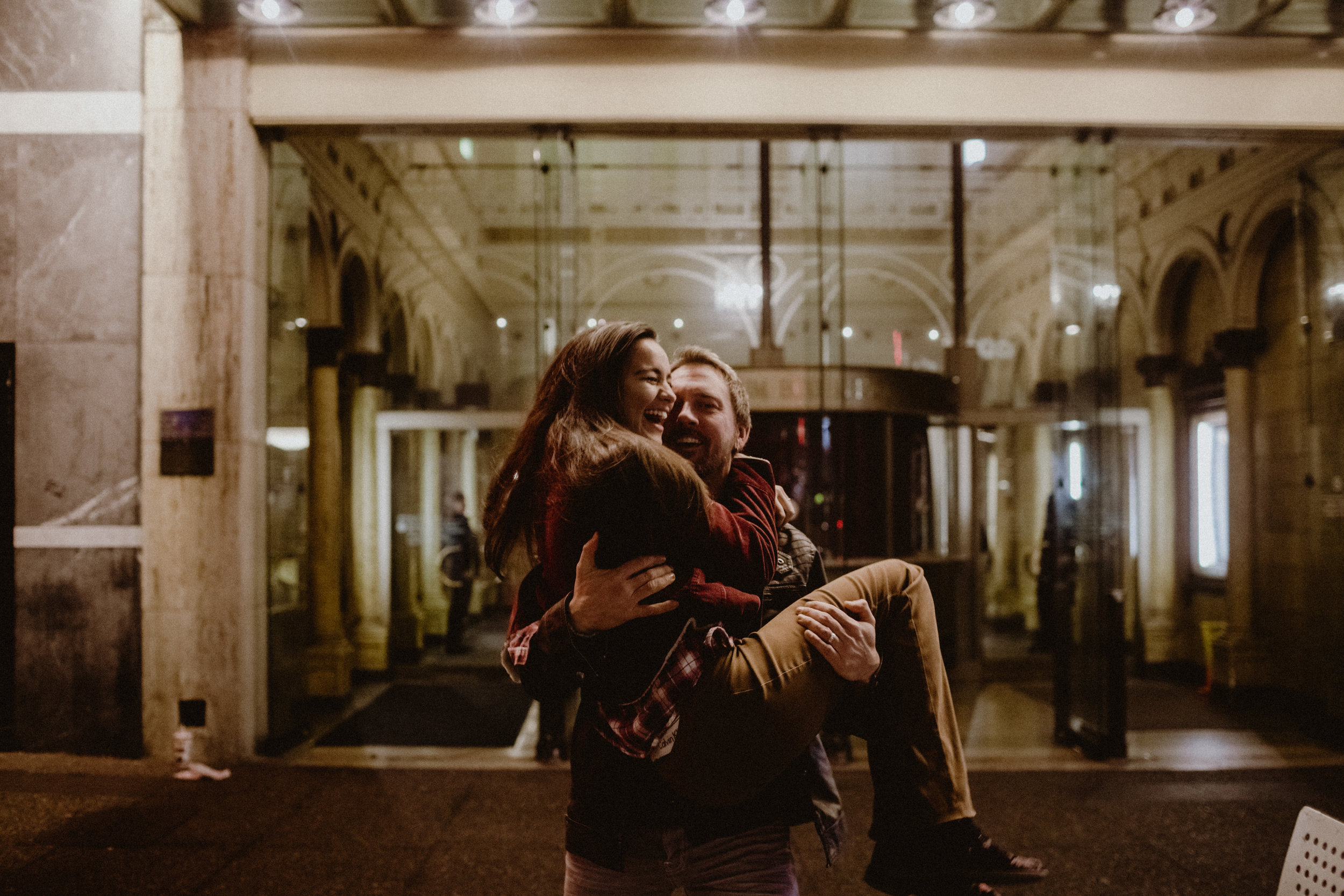 A romantic photo of an engagement session in downtown Vancouver.