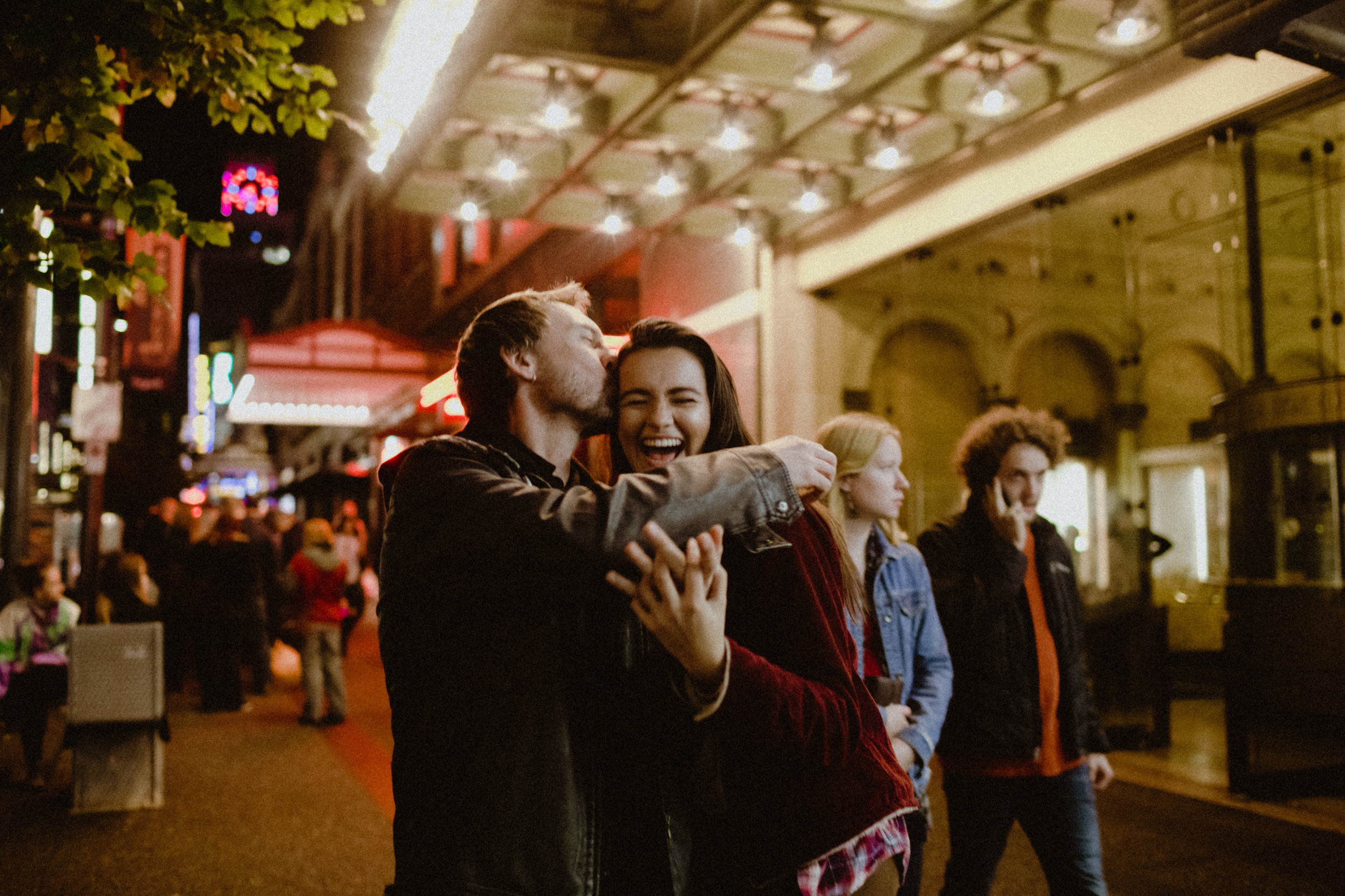 A joyful and romantic photo of a proposal in downtown Vancouver.