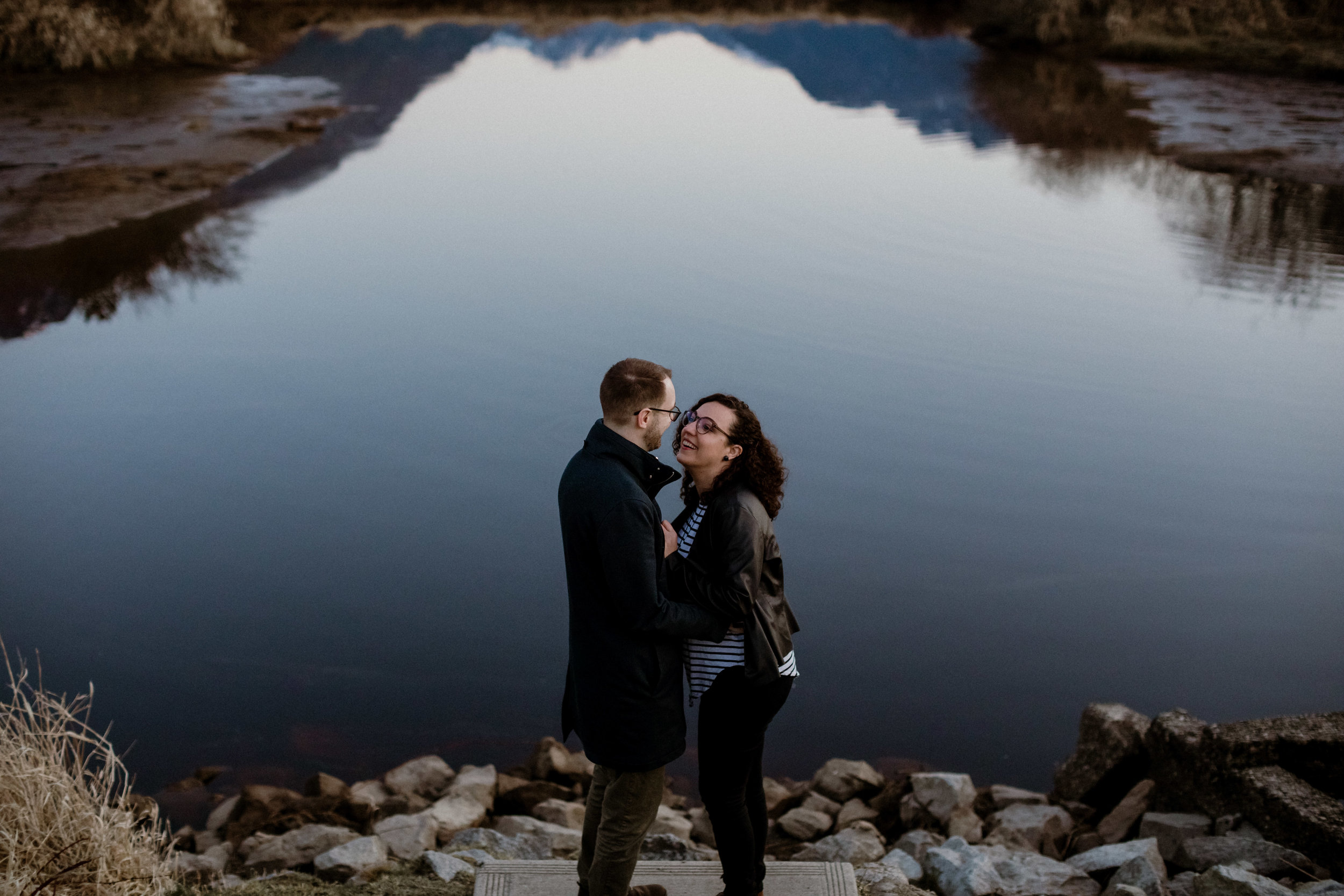 An intimate and romantic sunrise engagement photo of a couple at Pitt Lake in Vancouver.