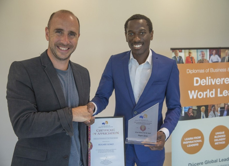 Presenting a scholarship at the Aus African Awards