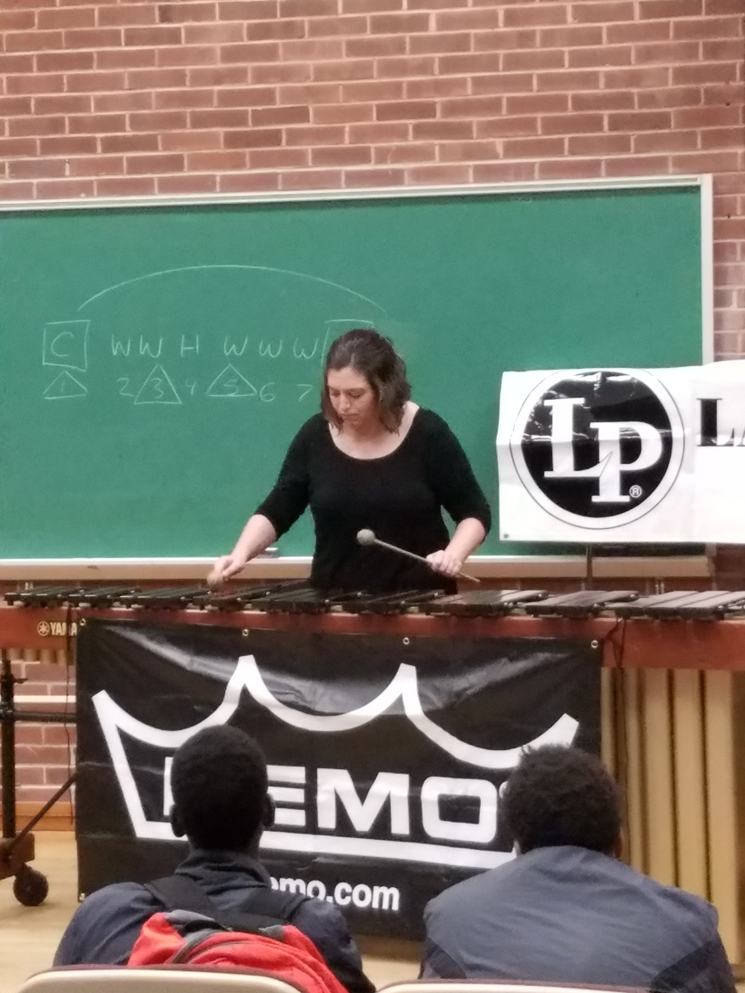 Methodist University student performing a two mallet solo during clinic