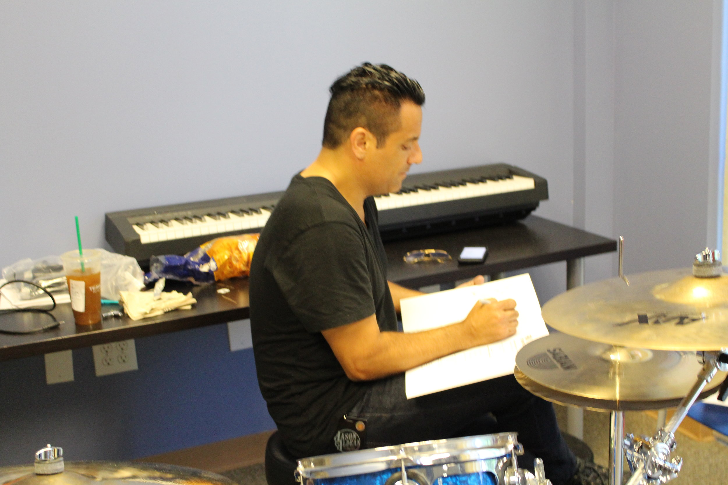 """Rich signing Colin's copy of """"FUNdamentals of Drumming for Kids"""""""