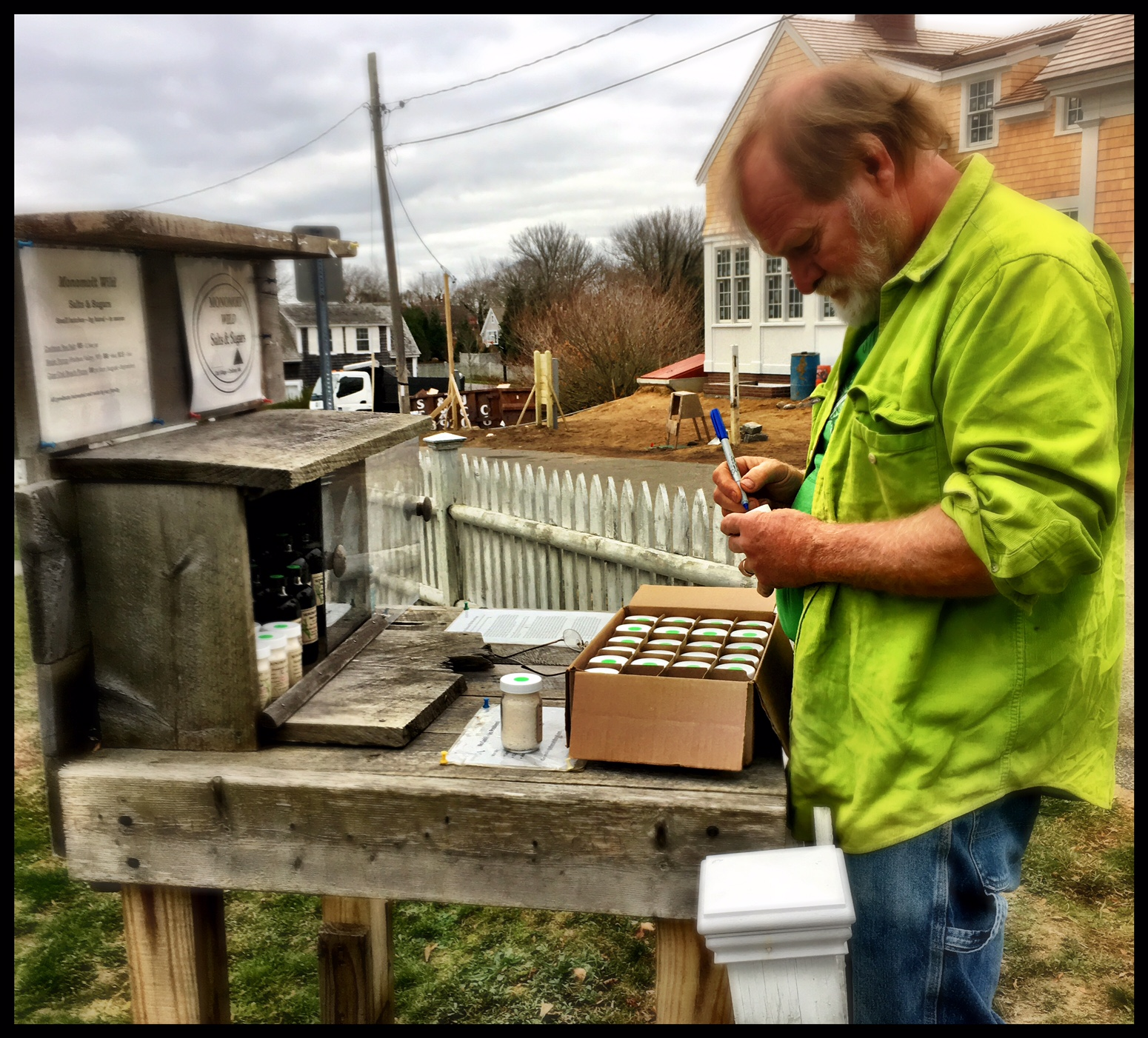 Christopher Weidman, labeling sea salt at the Old Chatham Village stand.
