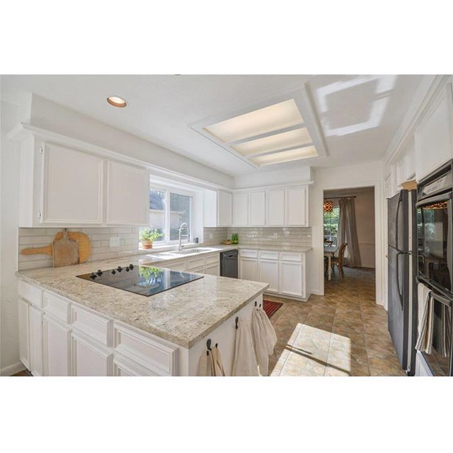 """More white paint for the win! Real estate listing pics from us selling  and when we bought. I love before and after... they're a great reminder of how far we've come... this """"after"""" isn't my dream kitchen or what I'd called perfect, but it's a whole lot closer than what we started with!"""