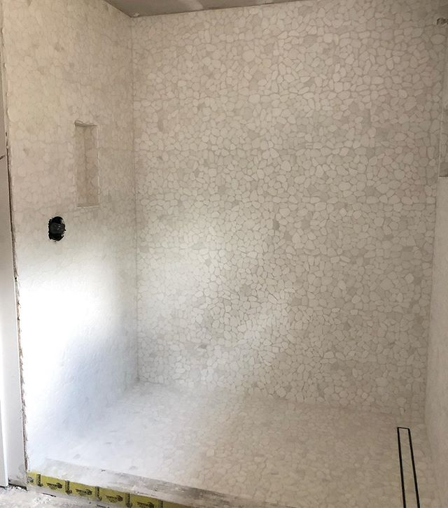 A spa like master bath is in the works! Can't wait to see everything come together, but these varying shades of white stones are gorgeous!! I love the vibe this shower is putting off already!