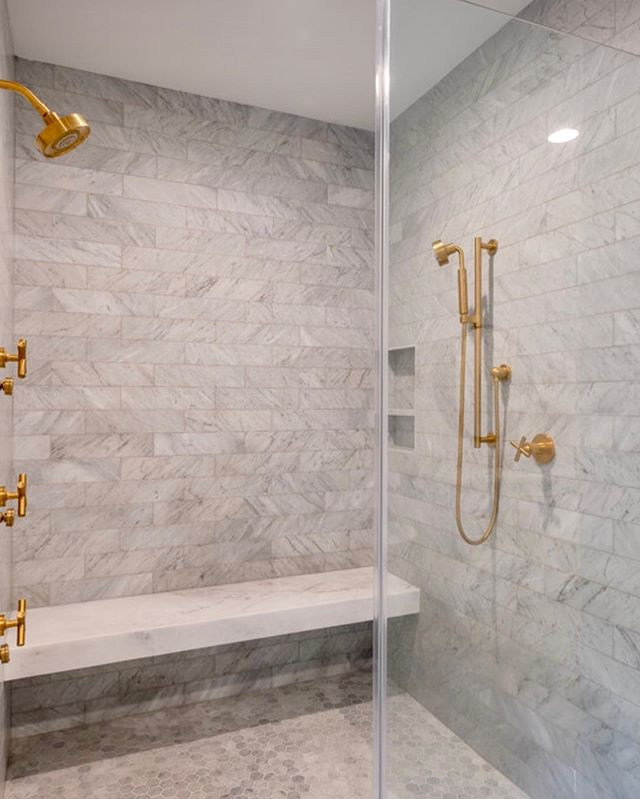 This shower is still one of my favorite projects ... the marble and gold fixtures are a combo that never gets old! So sharp, so classic, yet a little sassy 😉