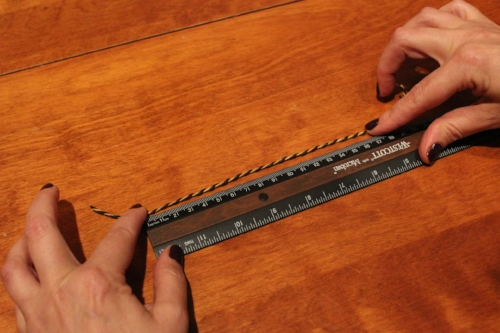 Then measure the length of the string and select a bracelet size that's at least as long.