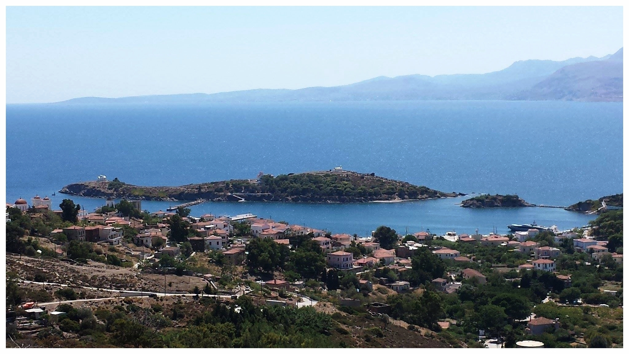 View of village, harbour and Chios from road above village