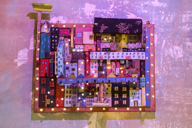 City of Scraps  25 x 24 in.  Acrylic on found wood and string lights