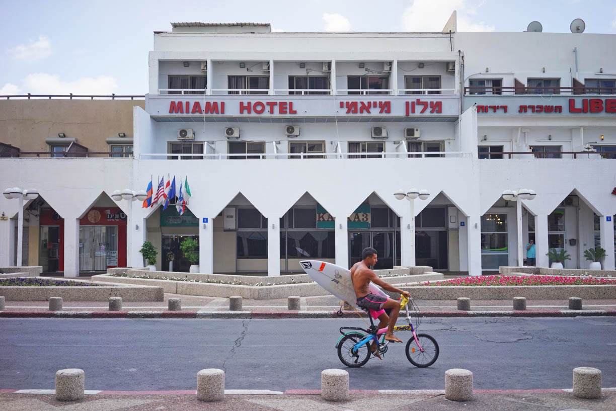 Miami hotel in Tel Aviv, surfer on a bike