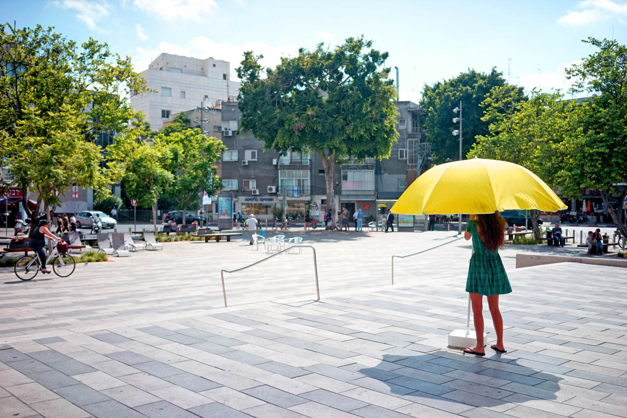 Tel Aviv, people in the city, summer, girl with yellow umbrella