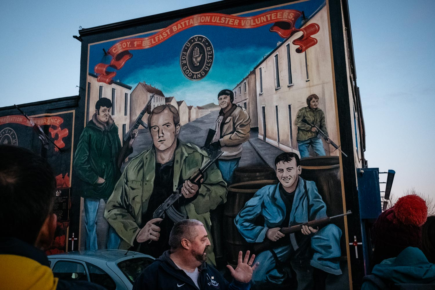 Mark, a former loyalist paramilitary man and former British soldier, and now tour guide with the Ex-Prisoners Interpretative Centre (EPIC), shows us a mural of the Ulster Volunteer Force (UVF) along Shankill Road.