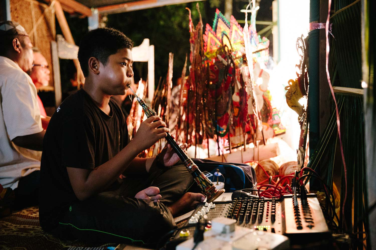 The youngest of the troupe: Abang Man's talented son plays multiple instruments.