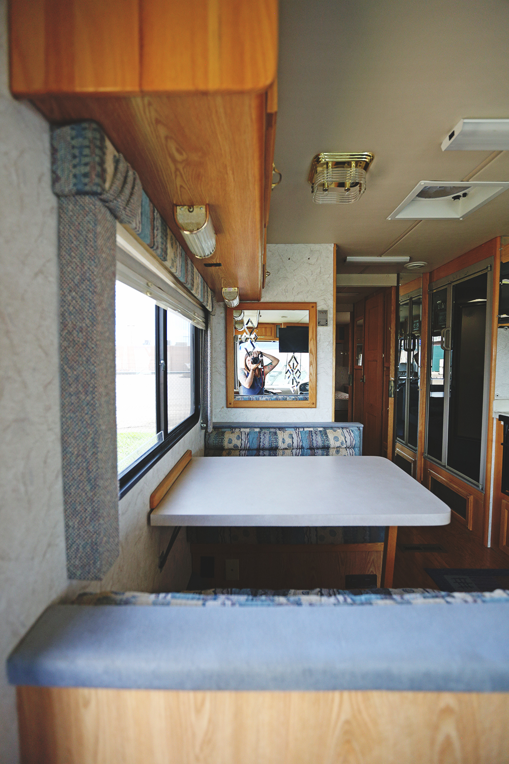 Serenica Landship: View to kitchen table from entrance steps, looking left.