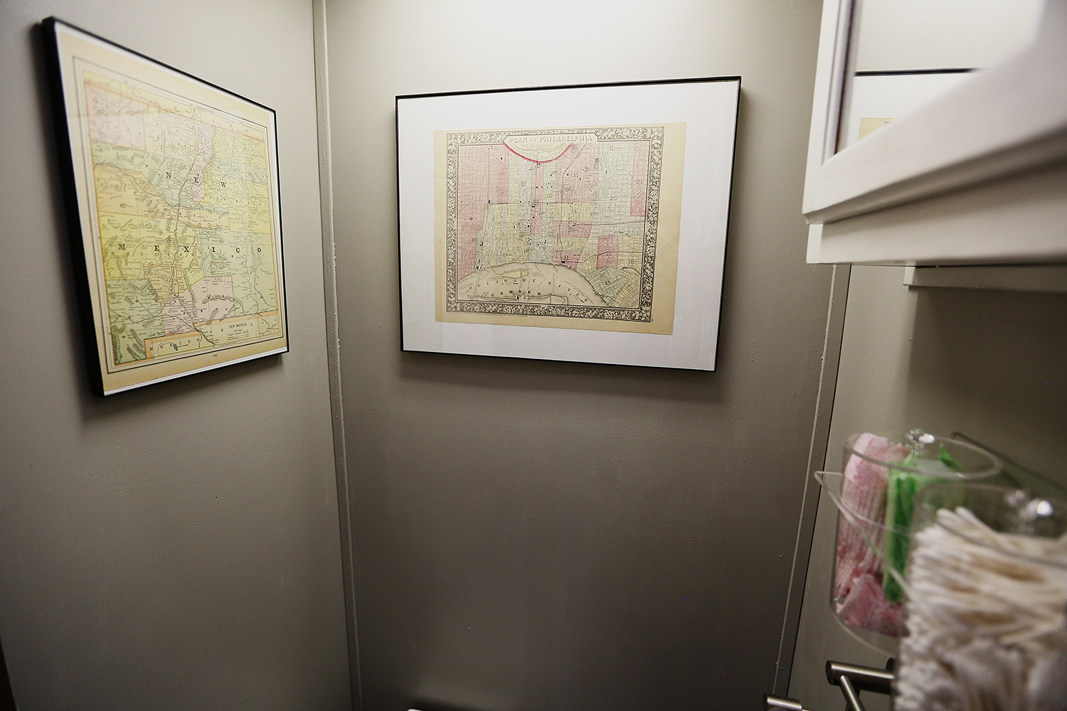 Bathroom cabinets/walls sanded and painted, installed canisters underneath the cabinets for additional and easy-access storage, hung old 1800s-era framed maps of Philadelphia and New Mexico we picked up at Powell's Books in Portland several years back (saved them for this very purpose!)