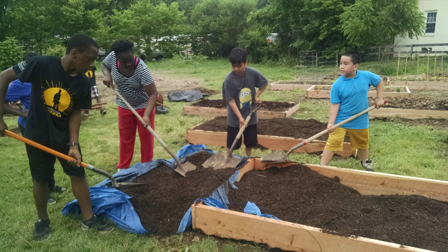 North End Residents Working on the North Pole Community Garden