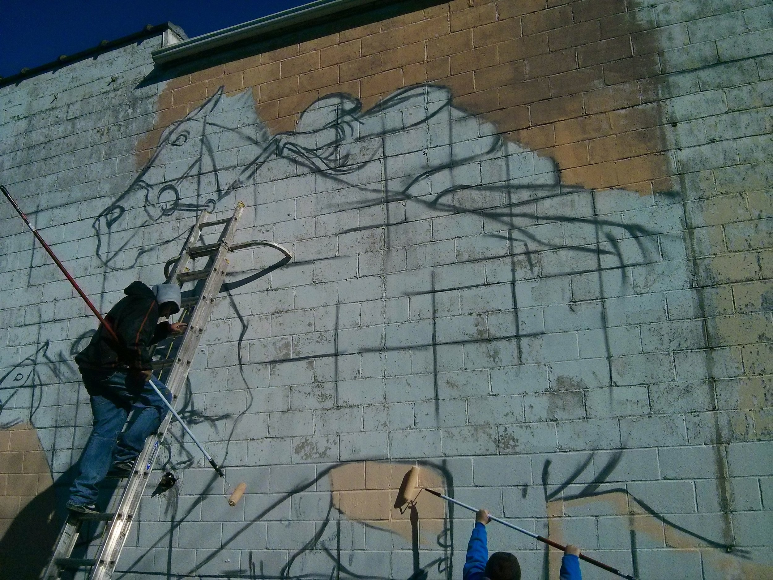 Muralist Odeith installing a   mural in the North End. C  ourtesy: Richard Young