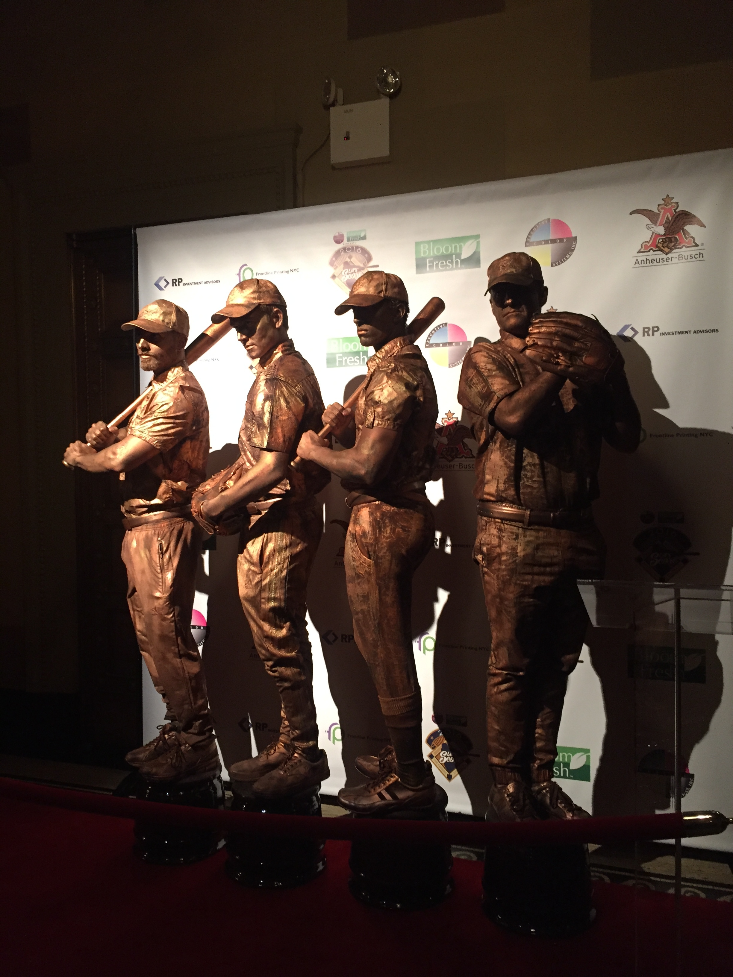 baseball living statues on pedestals.JPG