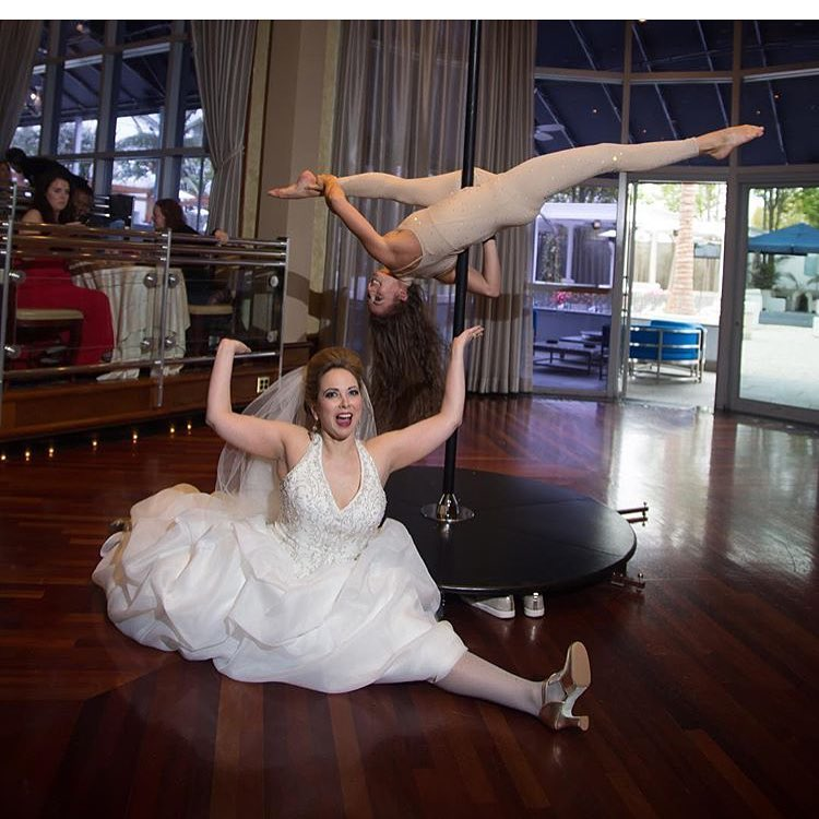 Pole Acrobat at Wedding Cocktail hour Chateau Briand Bride Splits.jpg