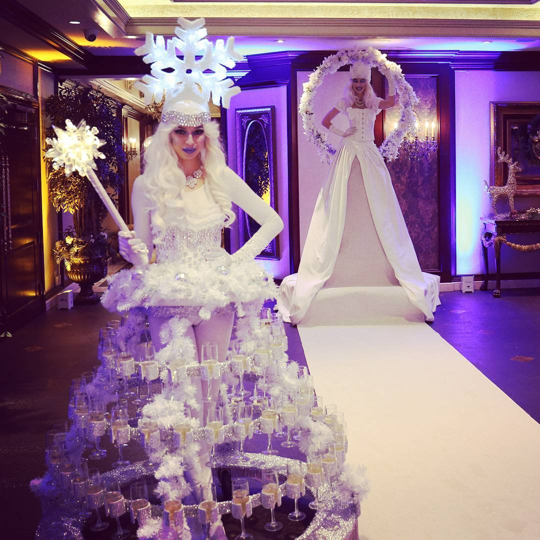 Cirque Central Living White Carpet and Champagne Skirt Winter Wonderland Snowflake Guest Greeters