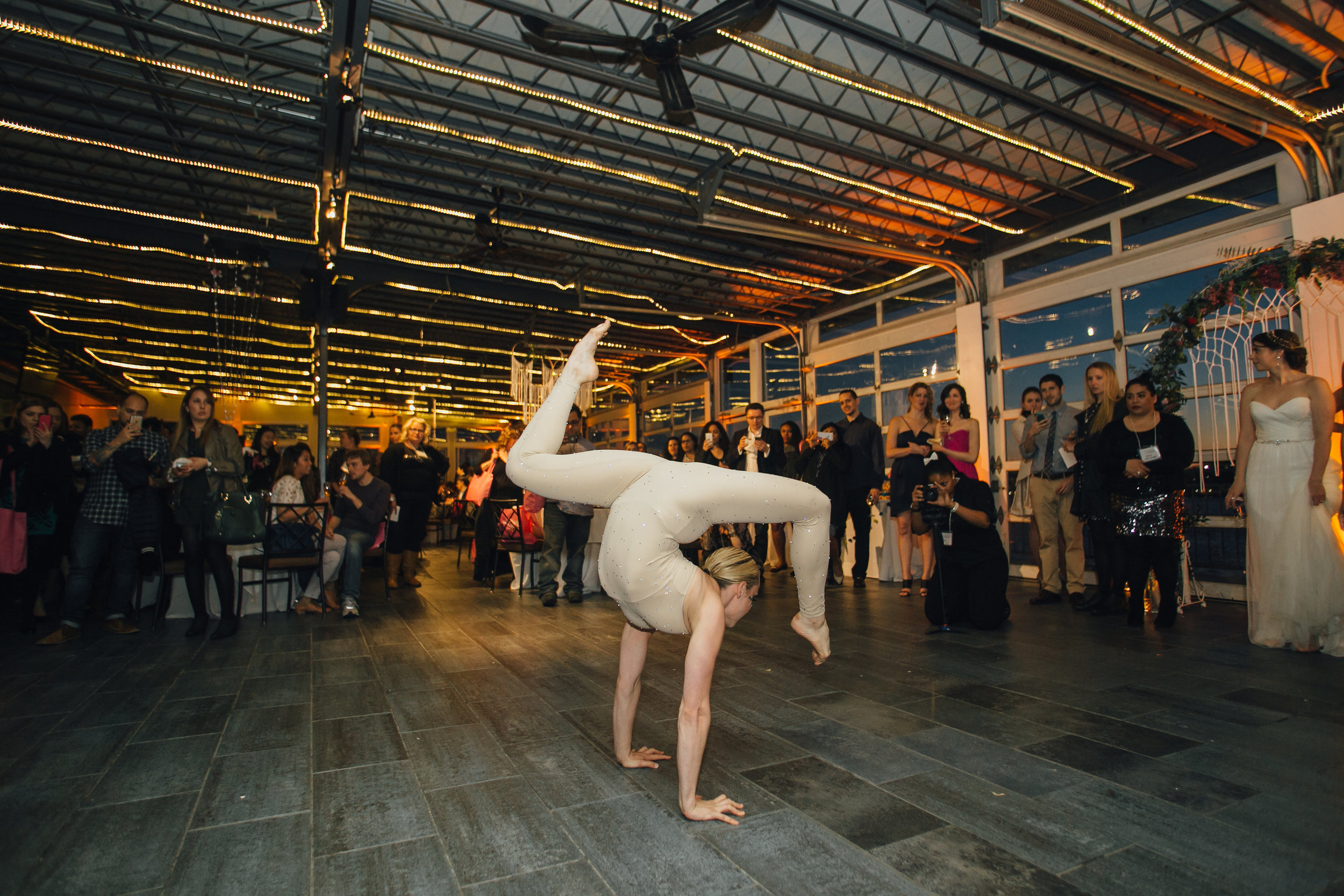 A contortion solo is a great way to break up the down time during dinner.    Wedding Venue: Sunset Terrace at Chelsea Piers