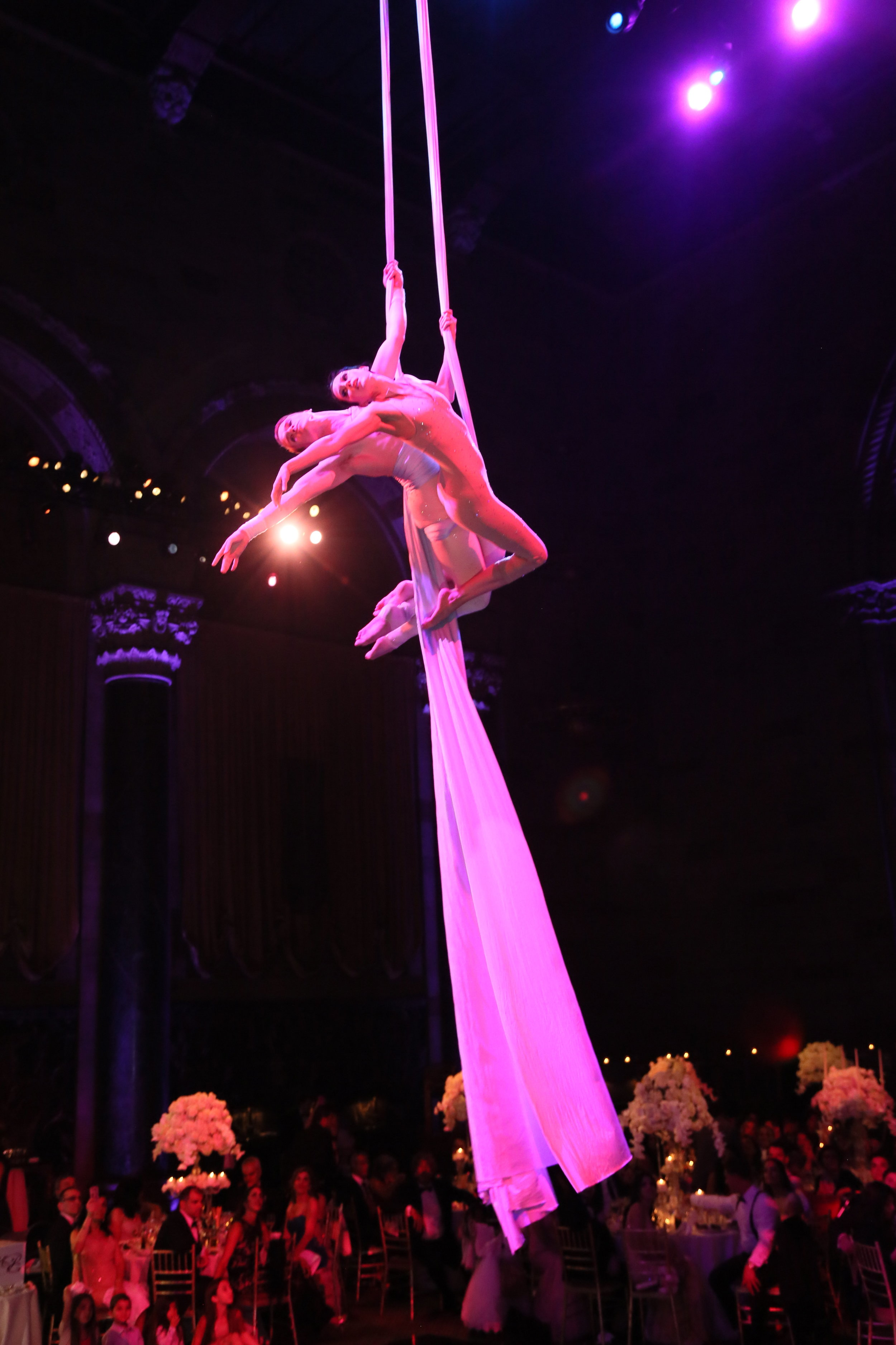 Dazzle the crowd with an aerial silks duet during your reception dinner like this beautiful newlywed couple did for their Wedding.  Wedding Venue: Cipriani
