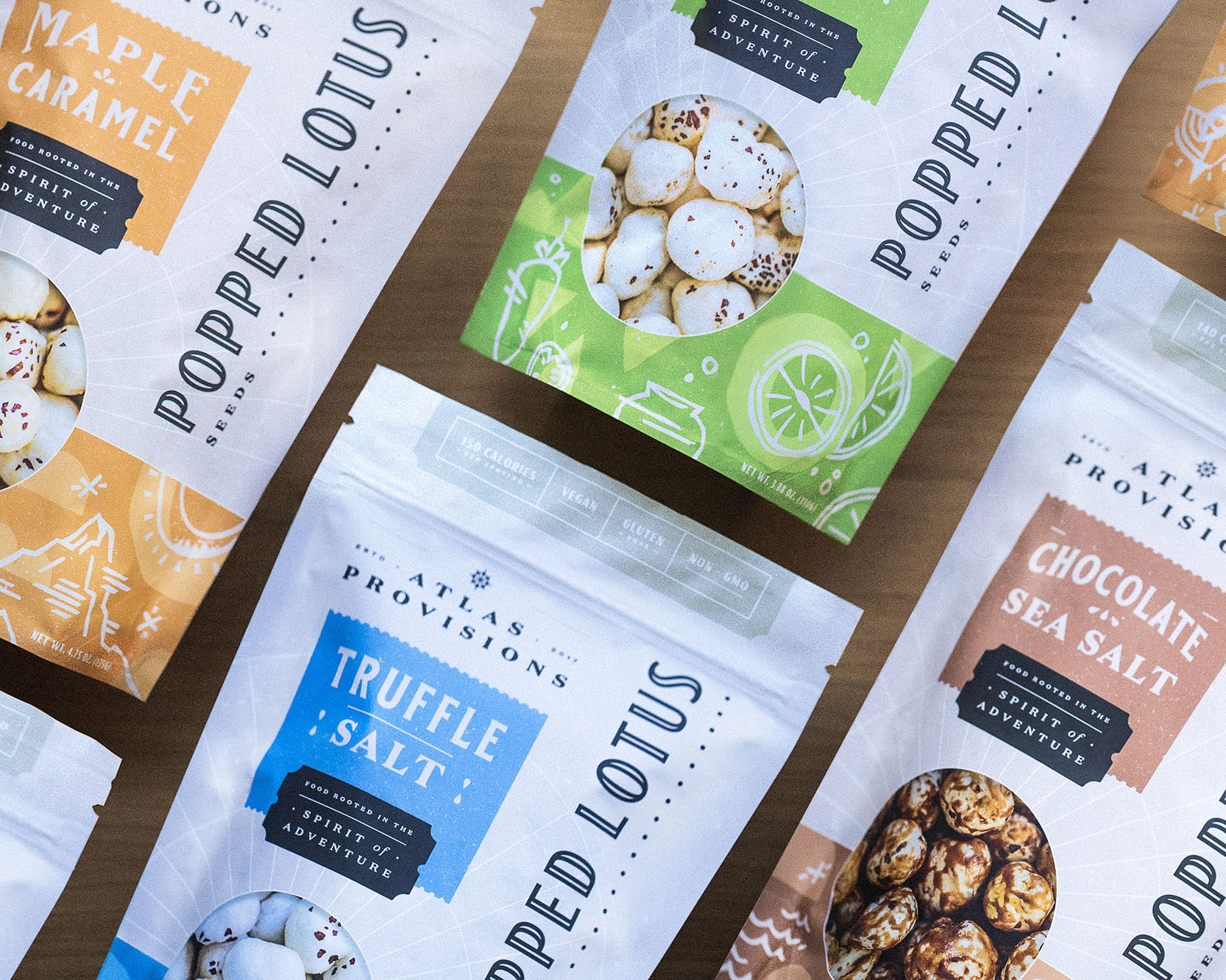 Lotus Pops - A snack inspired by global flavors, Lotus Pops are small-batch, popped lotus seeds coated with sophisticated seasonings.Cody Pettsdesigned the identity and packaging, but he needed travel journal inspired illustrations to represent sweet and savory flavor profiles and other worldly visuals...