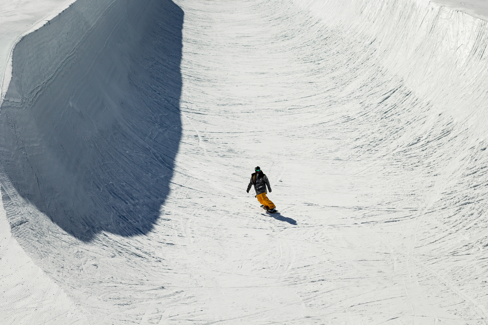 Someone snowboarding down an Olympic course