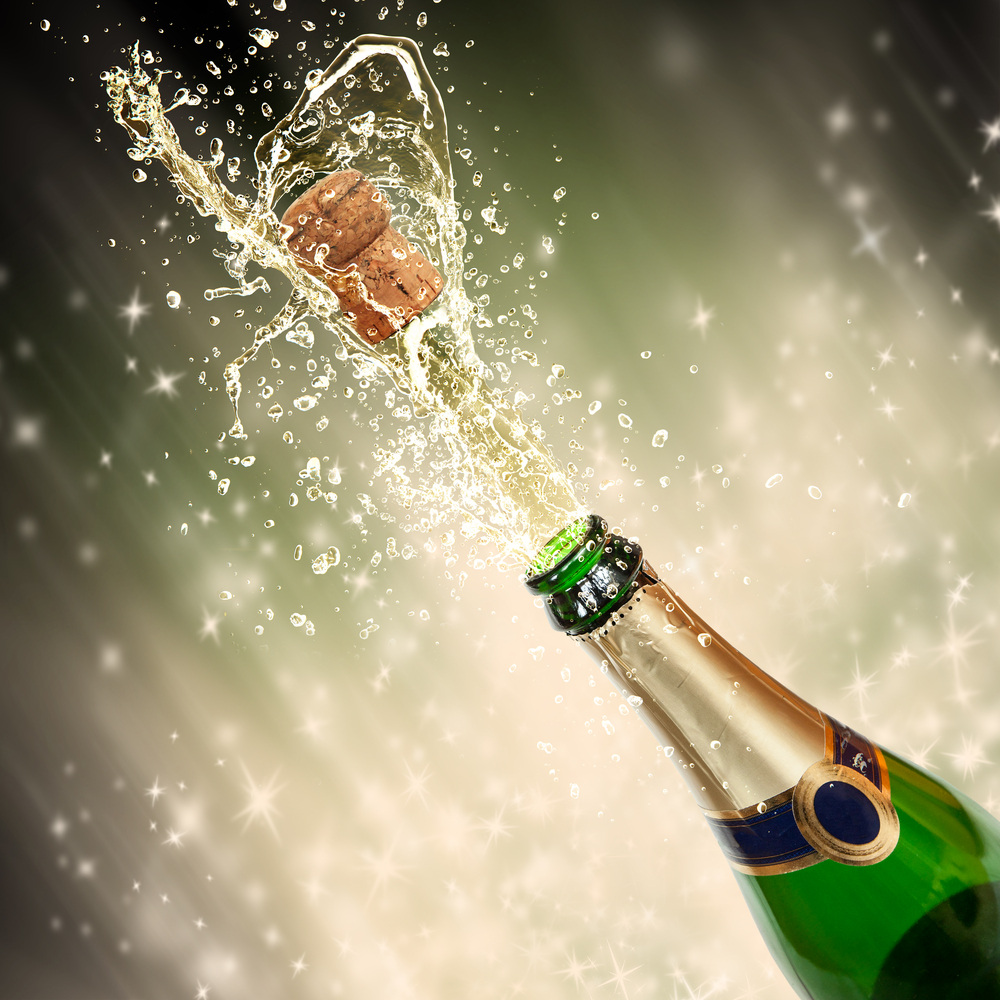 A Champagne bottle opening, cork being shot out