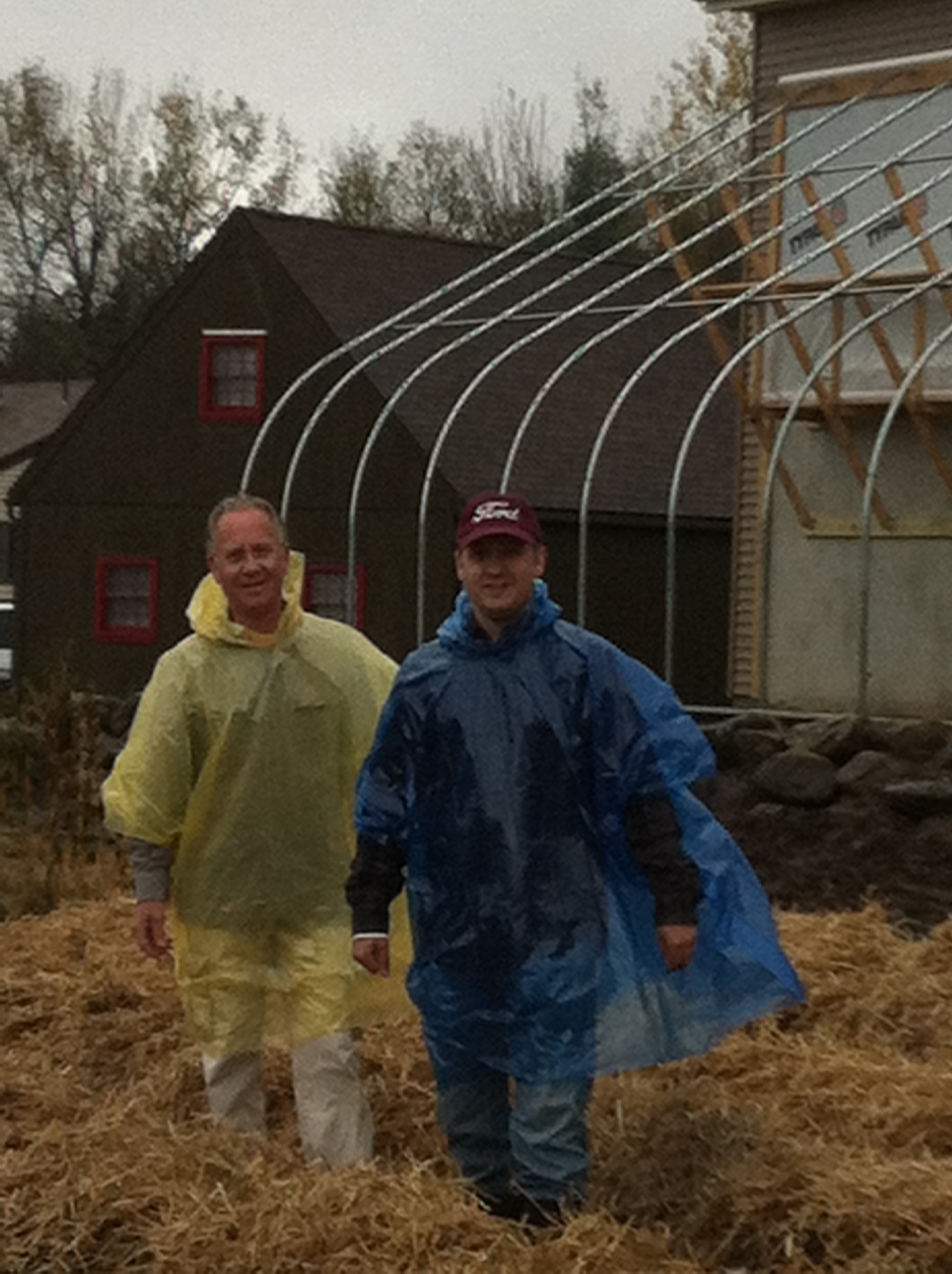 My son Sean and me laying down straw.