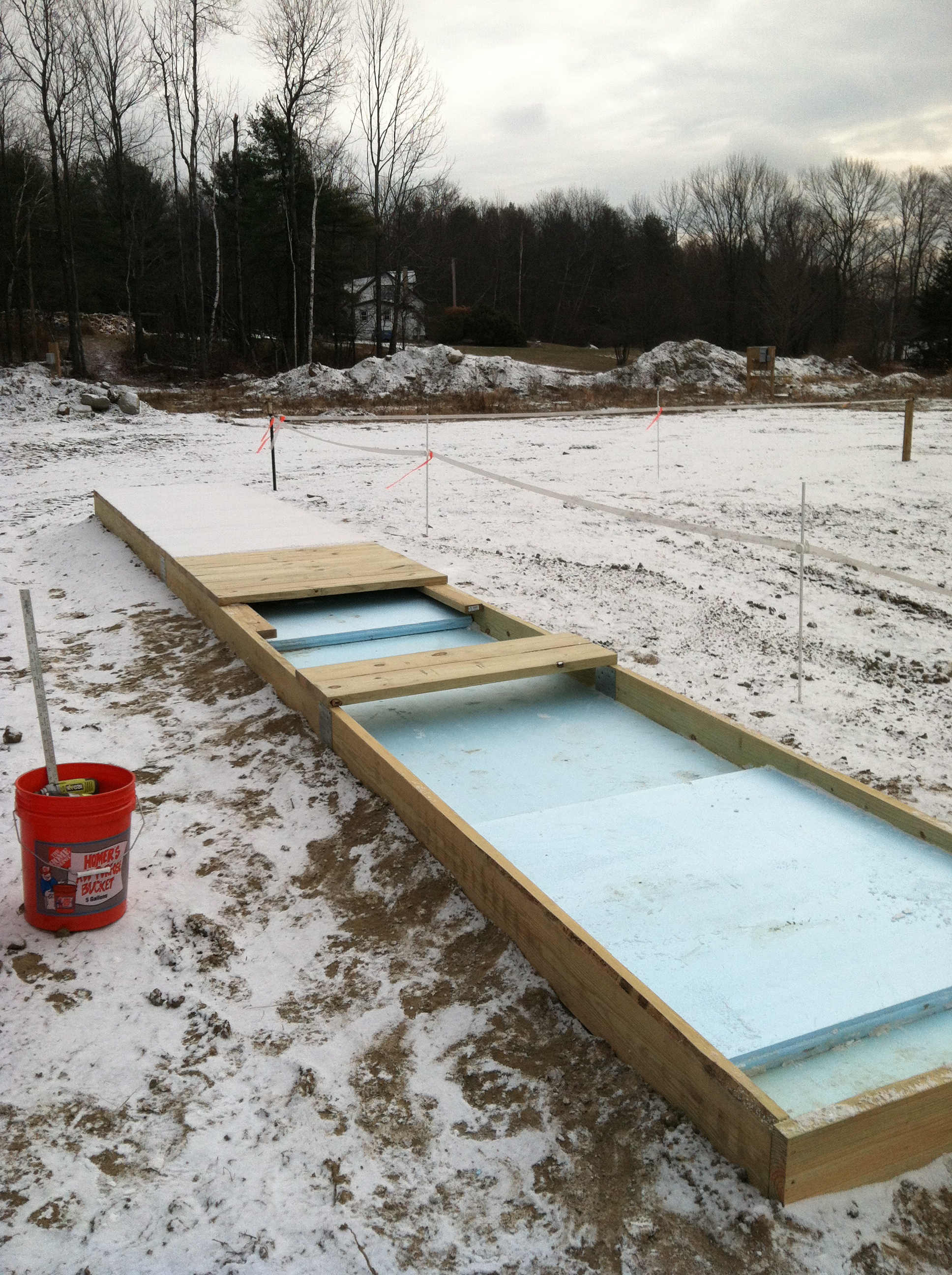 Insulating and covering the hatch covers on the underground tank.