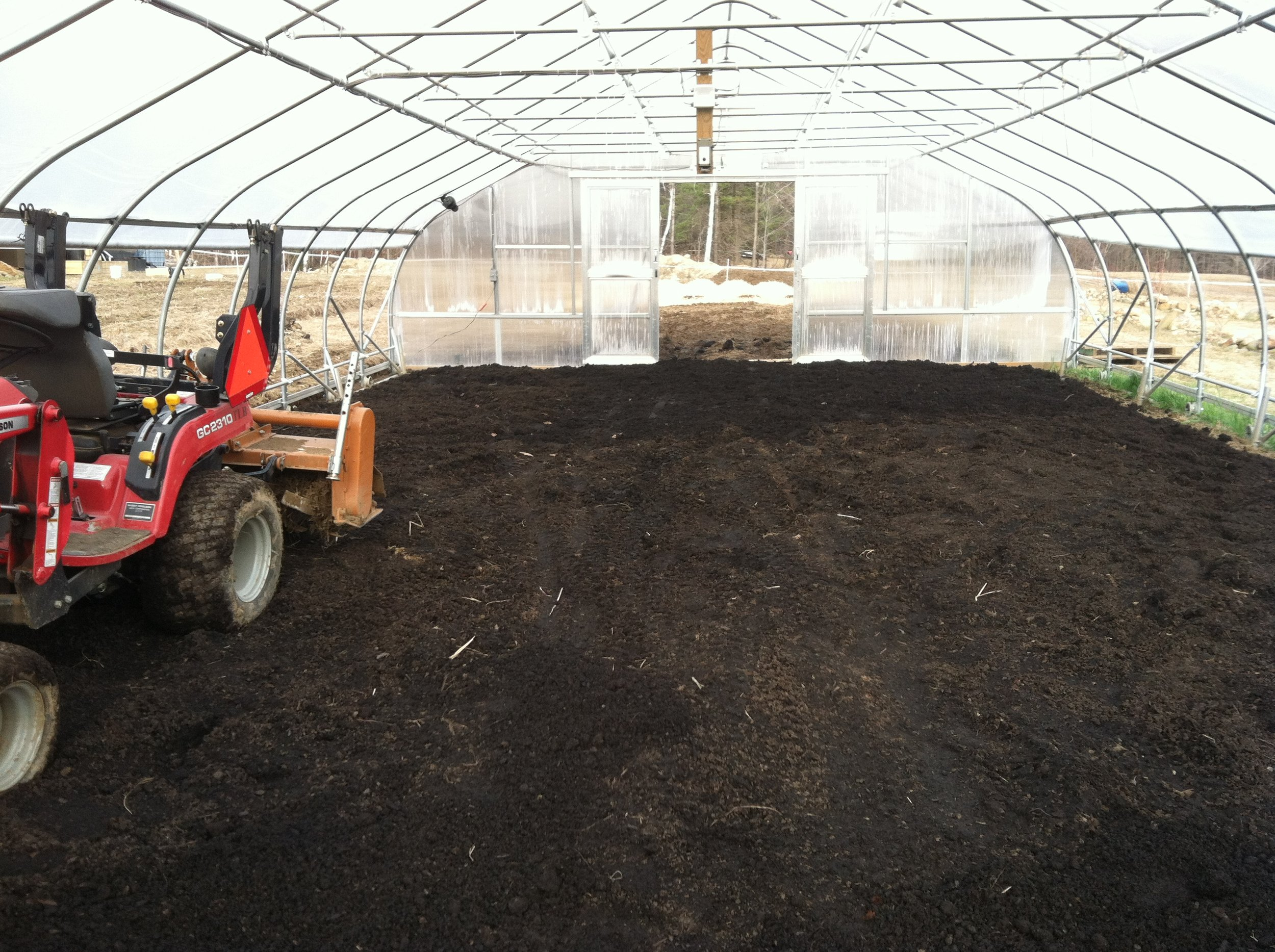 Completely spread, ready to be tilled.