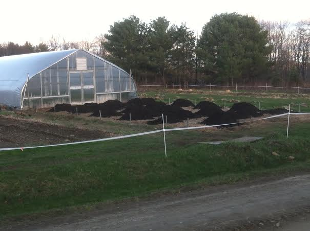 Piles of Biochar/compost mix.