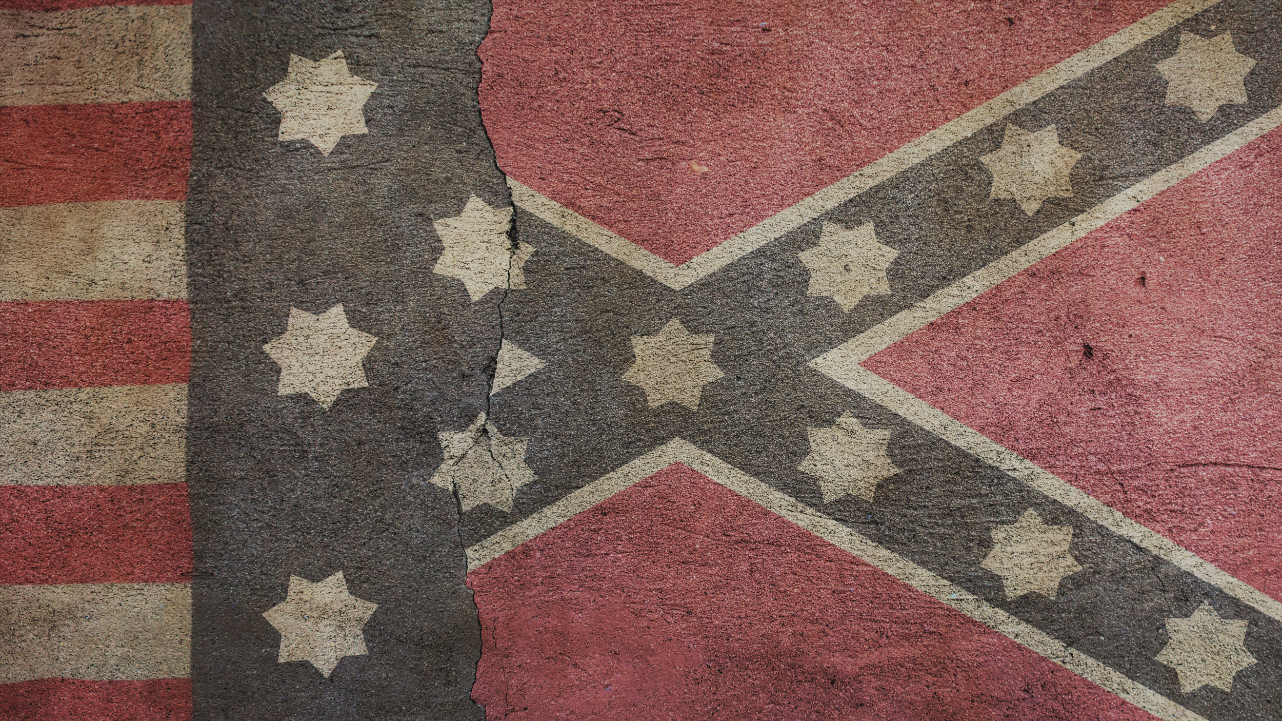 Confederate Flag and Union Flag on Cracked Concrete