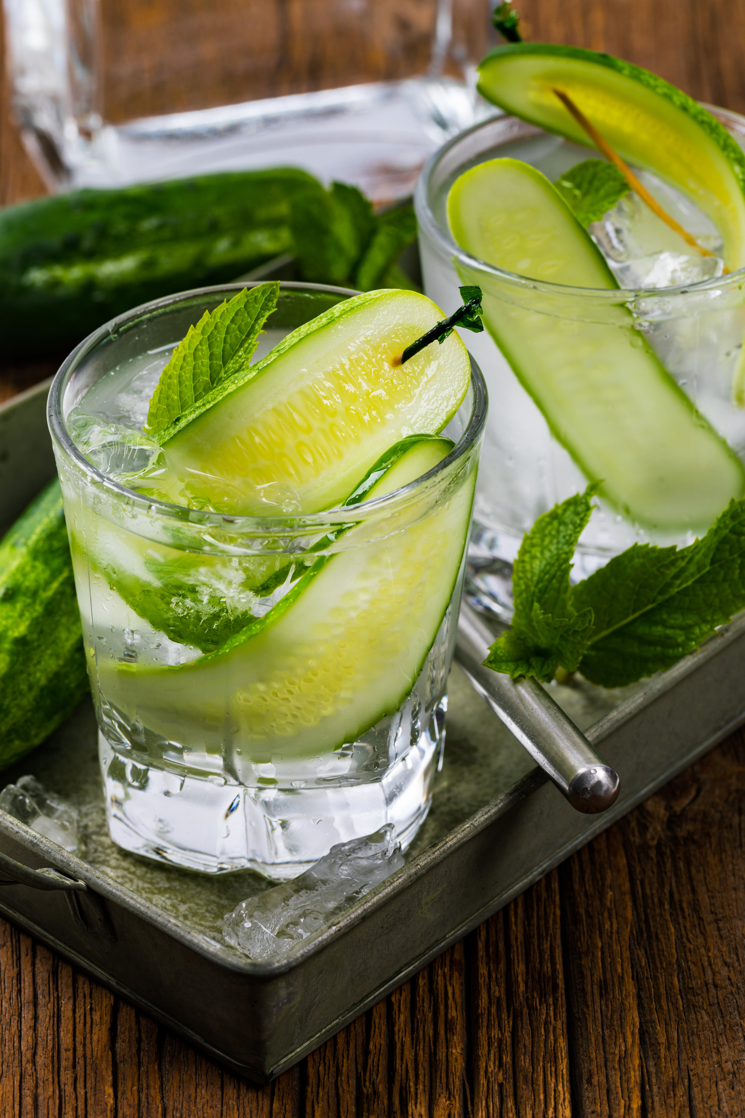 Tequila Eastside - 2 oz. blanco 100% agave tequila, .75 oz. simple syrup (to make, combine and stir one part  granulated sugar and one part water), 1 oz. lime juice, 2 cucumber wheels and 2 mint sprigs (or sage leaves).