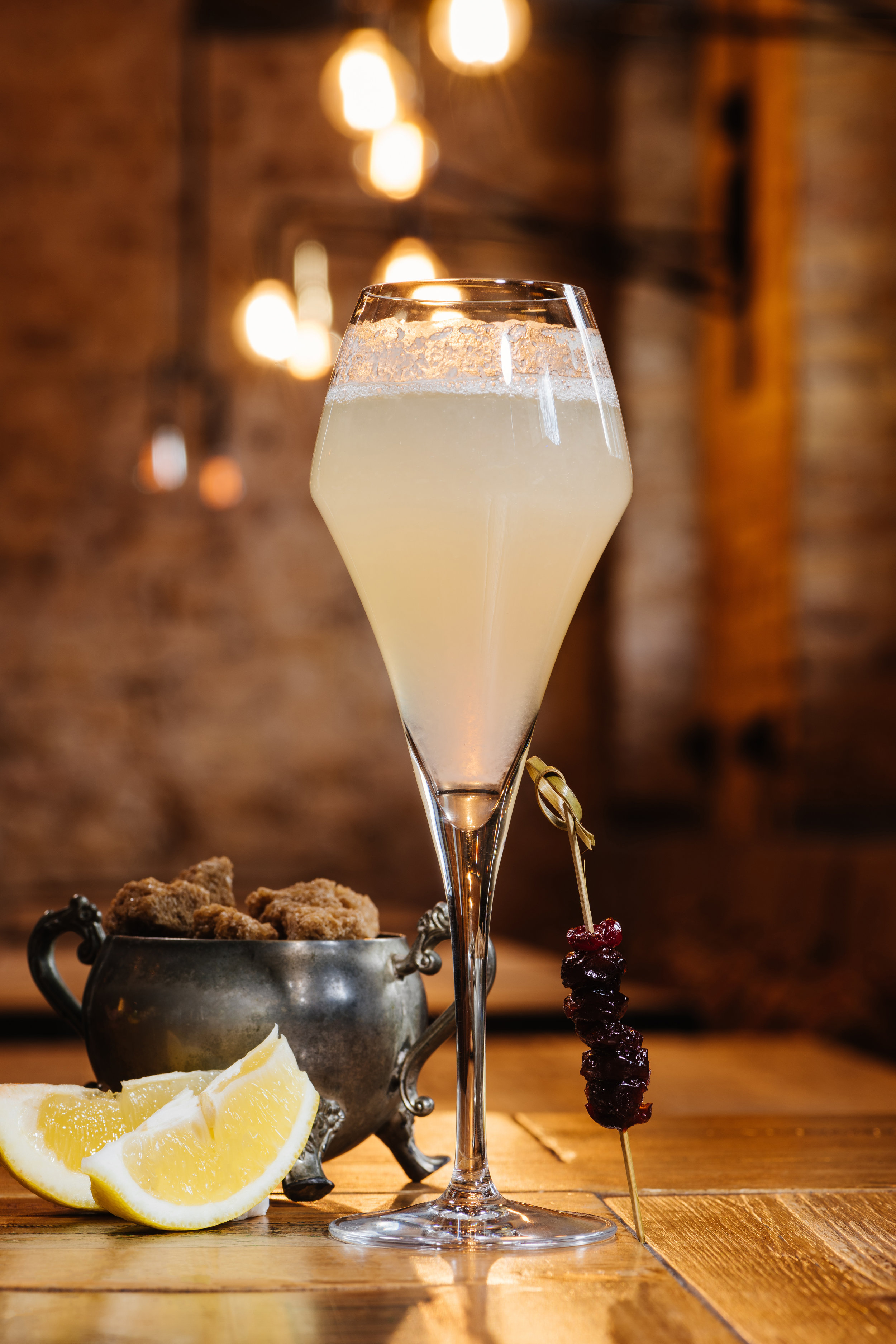 French 75 - 1 oz. dry gin, 1 oz. fresh lemon, 1/2 oz. 2:1 simple syrup (two parts sugar, one part boiling water) and   2 oz. cava.