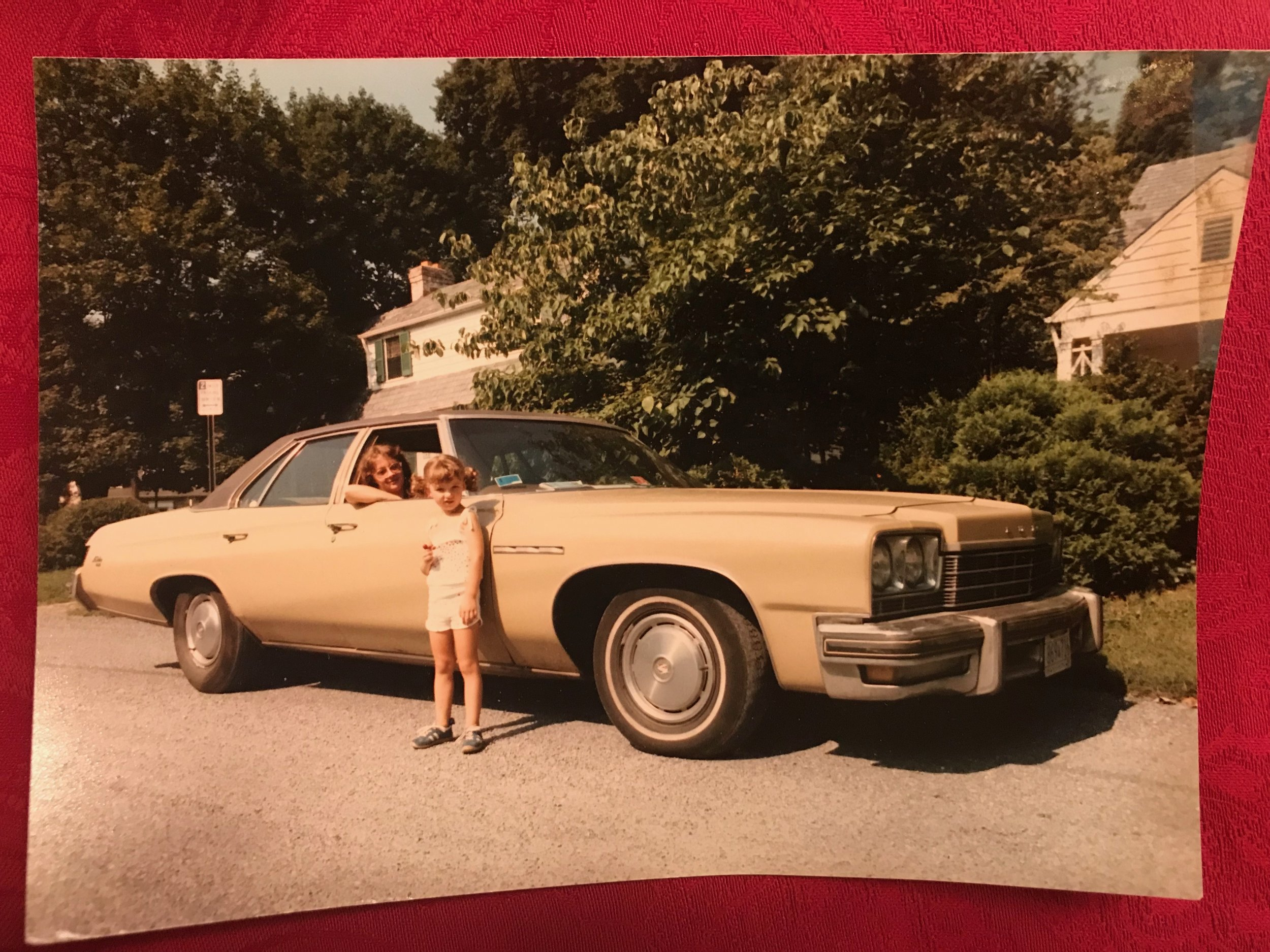 """Me and my mom in 1984, big pimpin' in our 1978 Buick LeSabre. Having just arrived in the States from Poland, we were on a cross-country road trip to see what this great nation was made of. It was such a boat that my 5'3"""" mom could take naps fully stretched out in the back seat as we cruised along."""