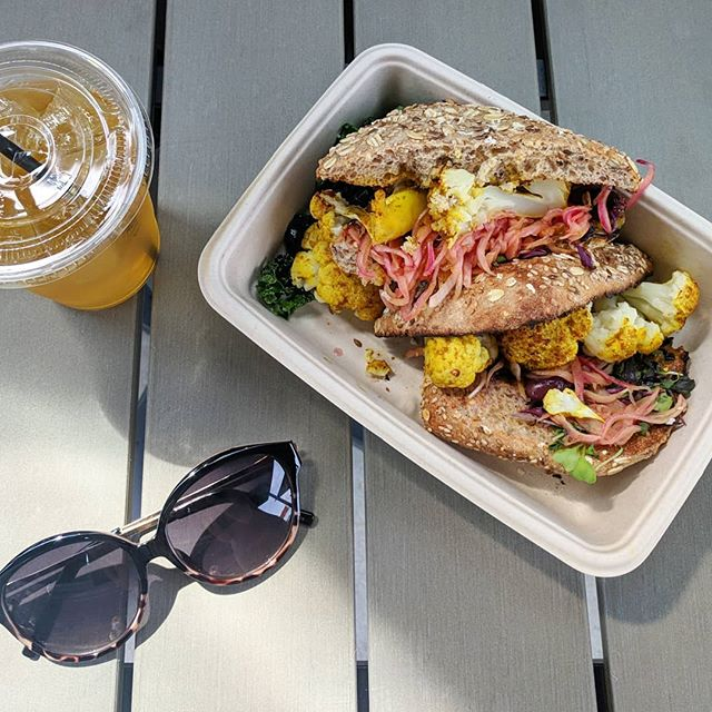 It finally feels like Spring in NYC 🙌 . I've been working on side projects during lunch lately and being able to tackle those while basking in the sunshine makes it that much more enjoyable. Add in this vegetarian schnitzel sandwich from @honeybrainslife and it doesn't get much better! . Roasted curried cauliflower on 8 grain ciabatta with micro greens, pickled onions, kalamata olives (which I picked off 🙊) and a tangy mango Israeli amba sauce 🤤