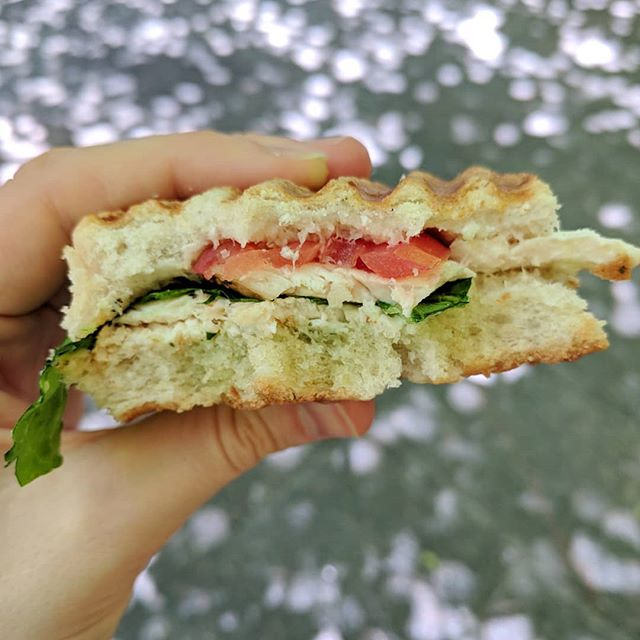"Took my lunch outside today in this beautiful weather! Loved this grilled chicken panini from @sanpaninonyc with toasted focaccia, lettuce, tomato and creamy herb dressing. . Anyone else tired of hearing how bread is supposedly killing us all? Especially white bread? I know I am 🙋 First of all, whole grains including whole grain BREAD can be a beneficial part of a balanced diet for numerous reasons. But also, white bread can be amazing in its own way...like it tastes so freaking good. I totally used to be in the ""I don't eat white bread anymore"" camp for no reason other than it didn't offer many nutritional benefits. Its totally okay to eat non-nutrient dense foods from time to time. The only time you really shouldn't eat certain foods is in the instance of disease or allergy. So there ya have it 😊"