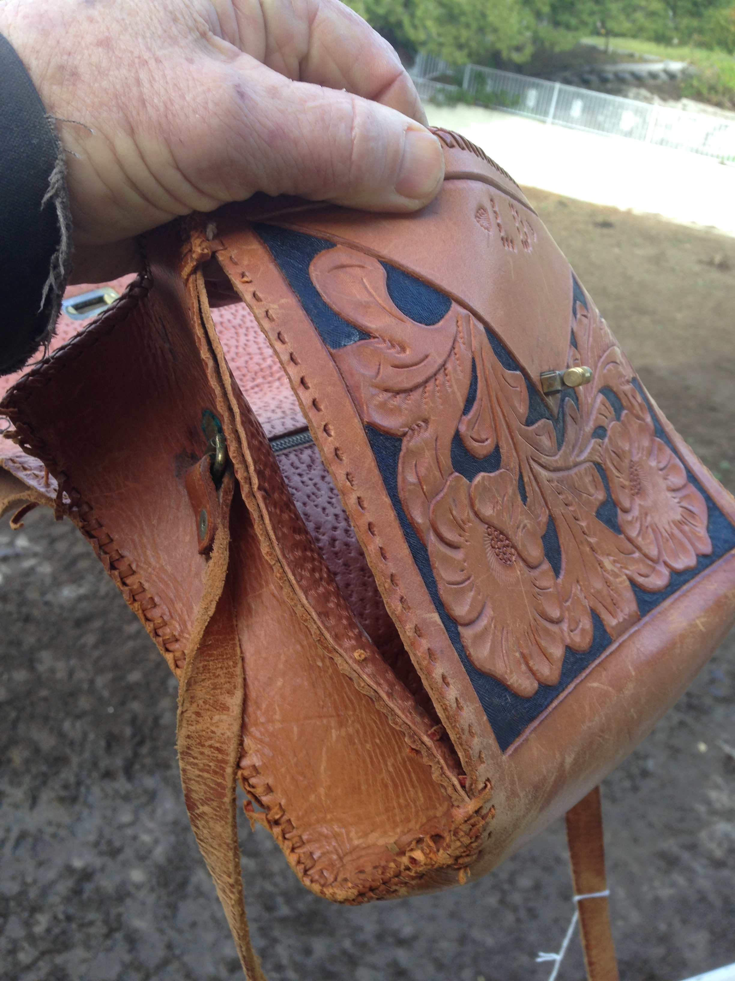 This purse was a valued heirloom whose leather stitching had rotted out over many years. We carefully restored it to its former glory/
