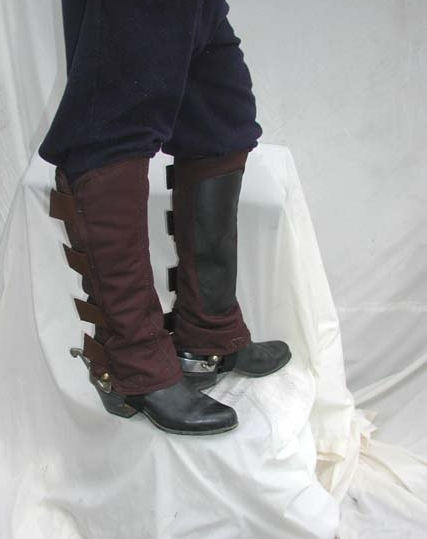 """I like canvas leggings that I designed with Velcro closures and a buckle strap on the bottom. I also ride mostly in leather boots with a higher heel to stop the foot going too deep into the stirrup. And whatever boot you wear should be elastic sided, to aid in a release. Chances are excellent that your foot will slide out of the boot, should your foot get caught in a stirrup. I like to wear spurs because -- I like to wear spurs. They are there if I need them, and they are there if I don't. I like dull clunky """"loud"""" spurs so everyone knows I am wearing them."""