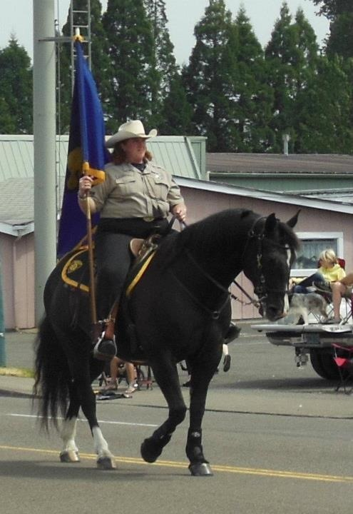 Amy Vanderzanden rides in a parade in her Mustermaster saddle from Colin Dangaard