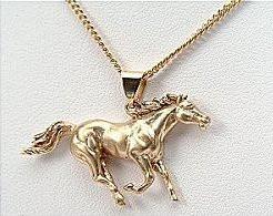 Galloping horse gold pendant