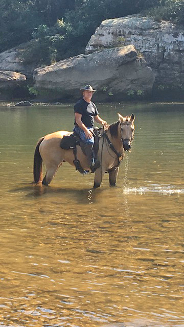 Jody and Remington in a river in a Patrol Poley