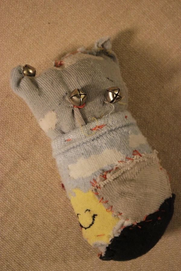First Pock-it Pal made from old socks and jingle bells (2003).